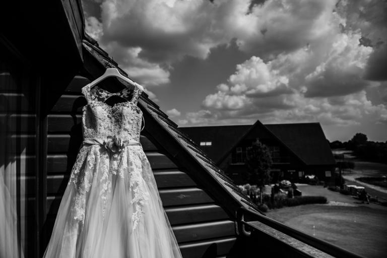 Wedding Dress hanging on balcony
